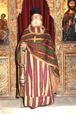 Palaichori Morphou, church of Agios Loukas, the priest Neophytos in 18th century sacerdotal costume.