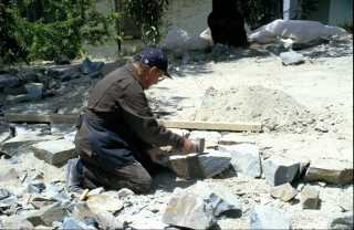 Kyperounta, the garden of the Museum of the Holy Cross. Work during the laying of the stone path, 1994.